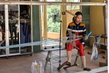 Brocade weaving using draw looms in My Nghiep village
