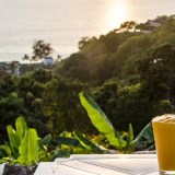 Drinking a mango smoothie and watching the sun set over the Andaman Sea in Phuket.