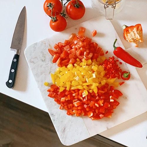 Jaye rockett kitchen worktop marble chopping board peppers tomatoes