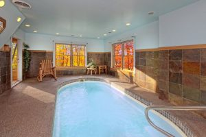 Secret Splash is a private two bedroom cabin with a heated indoor pool located between Gatlinburg and Pigeon Forge