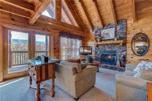 Chalet Of Dreams is a luxury two bedroom cabin in Pigeon Forge located in Sherwood Forest Resort. It offers a mountain view, beautiful floor to ceiling stone fireplace, and more