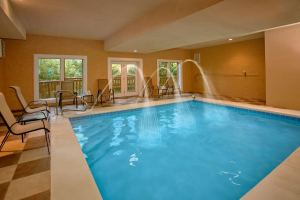 Cherokee Pool Lodge is a luxury 3 bedroom cabin with a heated indoor pool, huge theater room, and private fire pit area.