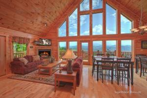 Grizzly Manor is a luxury five bedroom cabin in Pigeon Forge offering tremendous mountain views, a private convenient location, and luxury throughout the cabin