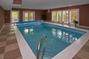 Live, Laugh, Love Pool Lodge is a four bedroom cabin in Cosby with an indoor pool, theater room, arcades, and many other amazing features.