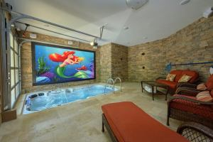 Poolin Around is a luxury two bedroom Pigeon Forge cabin rental with an indoor pool, 9 hole private mini golf course, putt-putt golf course, theater in pool, fire pit, huge walk-in shower, large master suite, and quality high-end finishes throughout the cabin