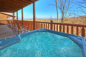 Shakonohey is a four bedroom cabin in Pigeon Forge with an amazing long range view. It features an amazing location next to Dollywood in Hidden Springs Resort and luxury amenities including a community indoor pool