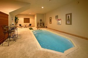 Splish Splash is a one bedroom honeymoon cabin in Pigeon Forge with an indoor pool and convenient location
