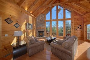 Tranquility is a luxury two bedroom cabin rental in Pigeon Forge. Located in Cedar Falls Resort, Tranquility is on acreage and offers privacy, a mountain view, quality throughout, and a new indoor pool addition.