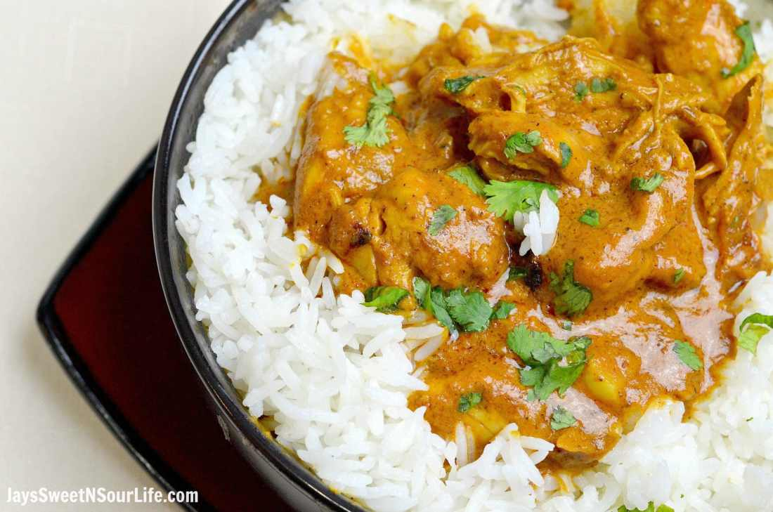 Indian Butter Chicken closeup inside of serving bowl. Instant Pot Indian Butter Chicken is a buttery chicken that is smothered in a creamy tomato based sauce.