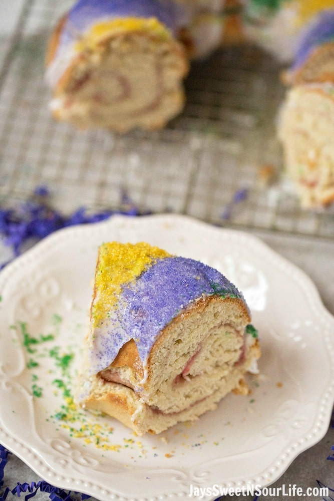 Mardi Gras King Cake Sliced Cake. Hands down one of my absolute favorite cake recipes. Create a festive cake that the whole family will love. Check out the full recipe to see what secret ingredient I use in my recipe.