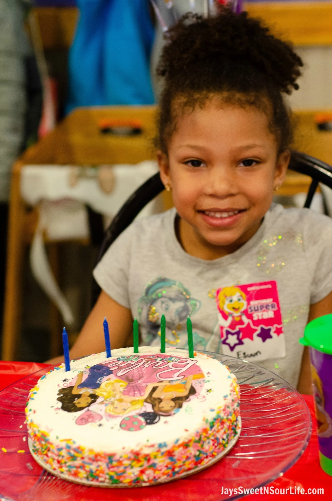 Chuck e cheeses VIP birthday Party offers new birthday cakes including one with Barbie. African American birthday girl with a Barbie BIrthday Cake.