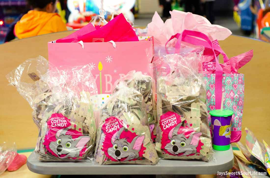 Chuck e cheeses VIP birthday Party Tickets and birthday gifts on table. Book your party today and have guests enjoy 2 hours of unlimited game play.