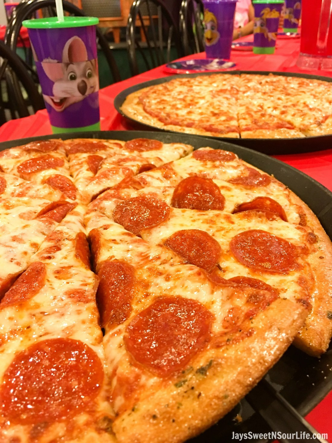 Chuck e cheeses VIP birthday Party pizza on table. Book your party today and have guests enjoy 2 hours of unlimited game play.