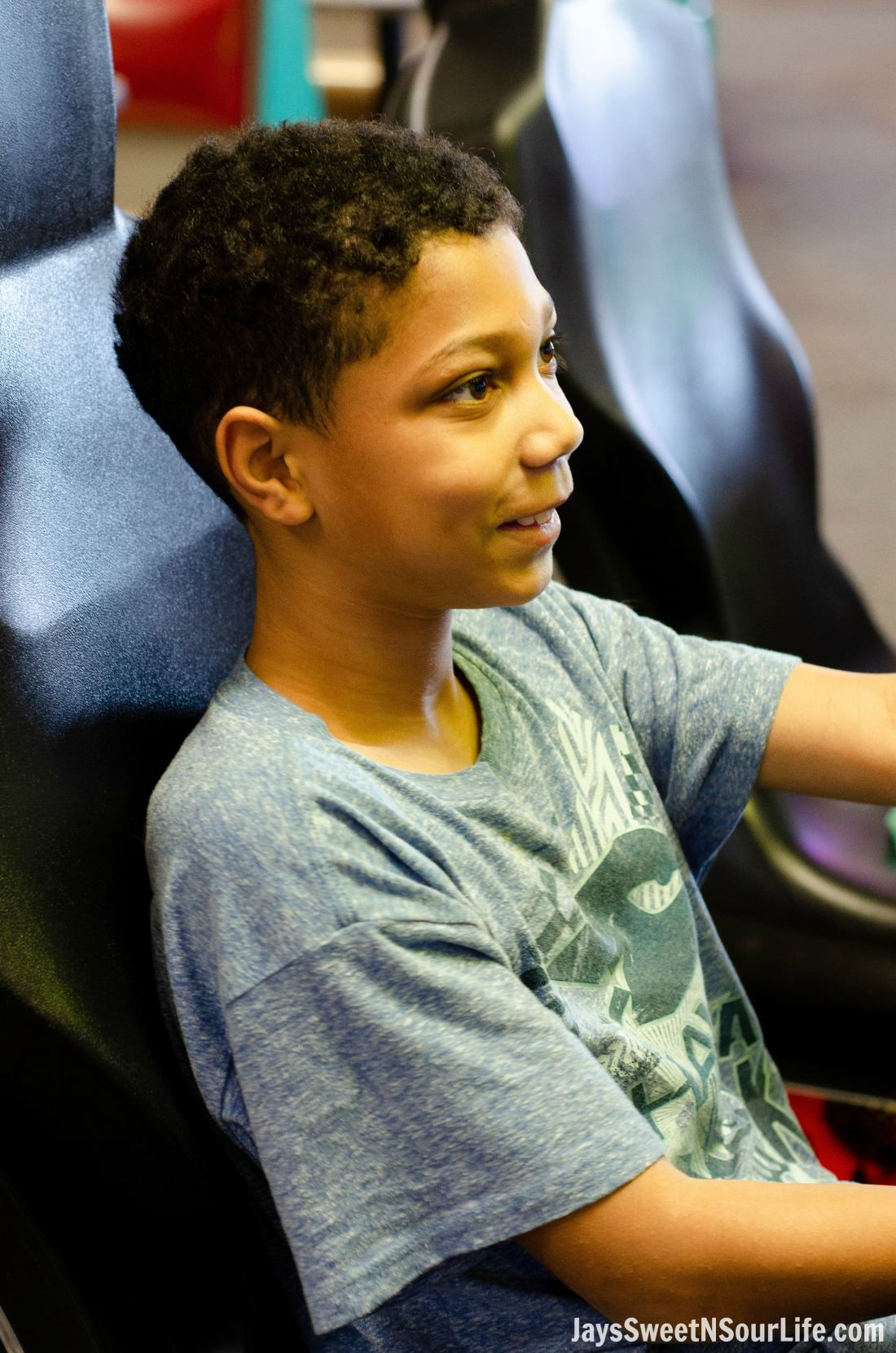 African american boy playing racing game at Chuck e cheeses VIP birthday party. Book your party today and have guests enjoy 2 hours of unlimited game play.