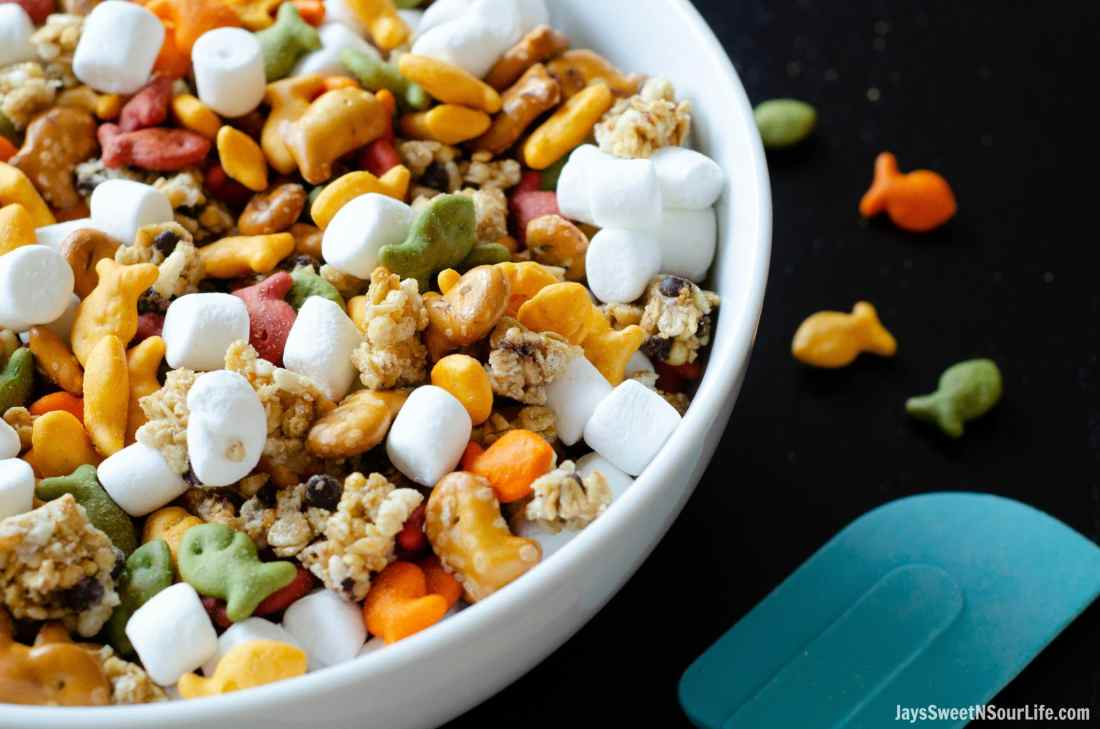 Goldfish crackers are my go-to! My families favorite on the go trail mix is sweet and oh so delicious. Try this Goldfish Trail Mix and take it on the go with your family to theme parks, parks, or your back yard.