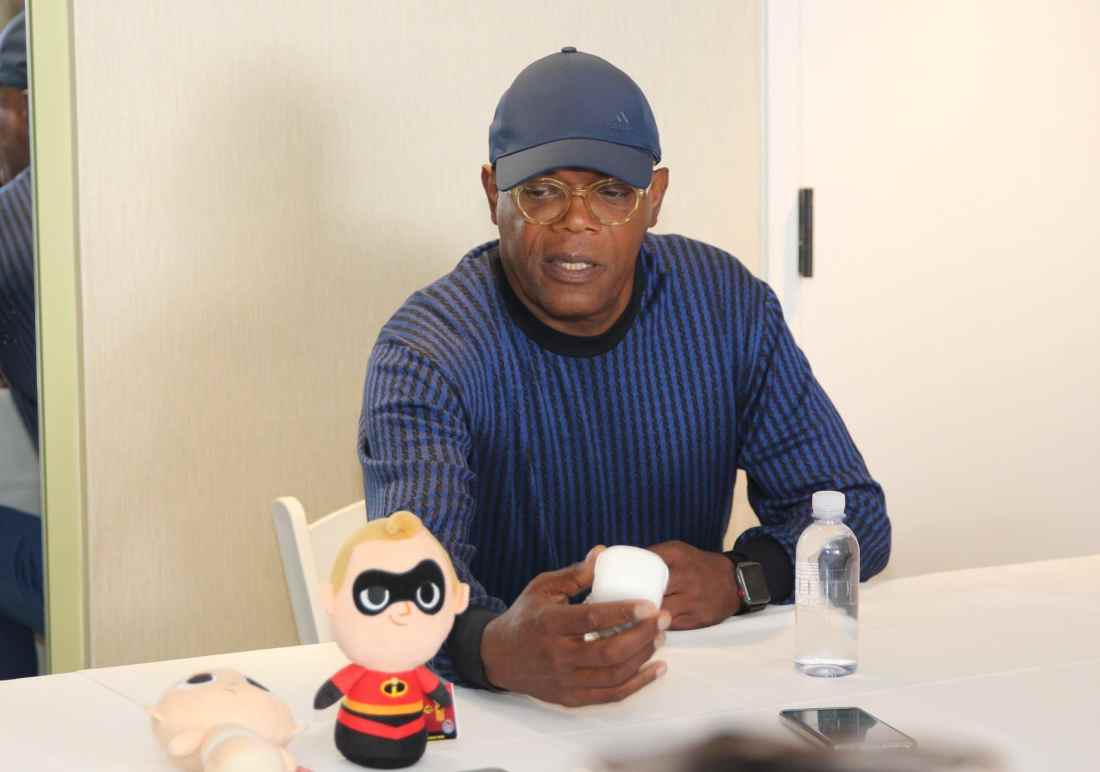Samuel L. Jackson in Incfredibls2Event Press Junket holding his Frozone Toy Funko Pop. The Incredibles 2 film will be in theaters everywhere June 15th.