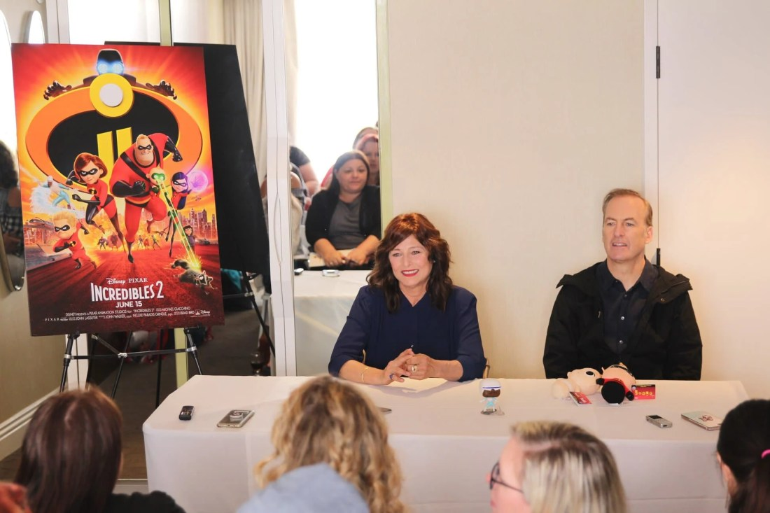 Incredibles 2 Interview with Bob Odenkirk & Catherine Keener Voices of Winston and Evelyn Deavor Sitting At Table. Disney Pixars Incredibles 2 film is in theaters everywhere today.