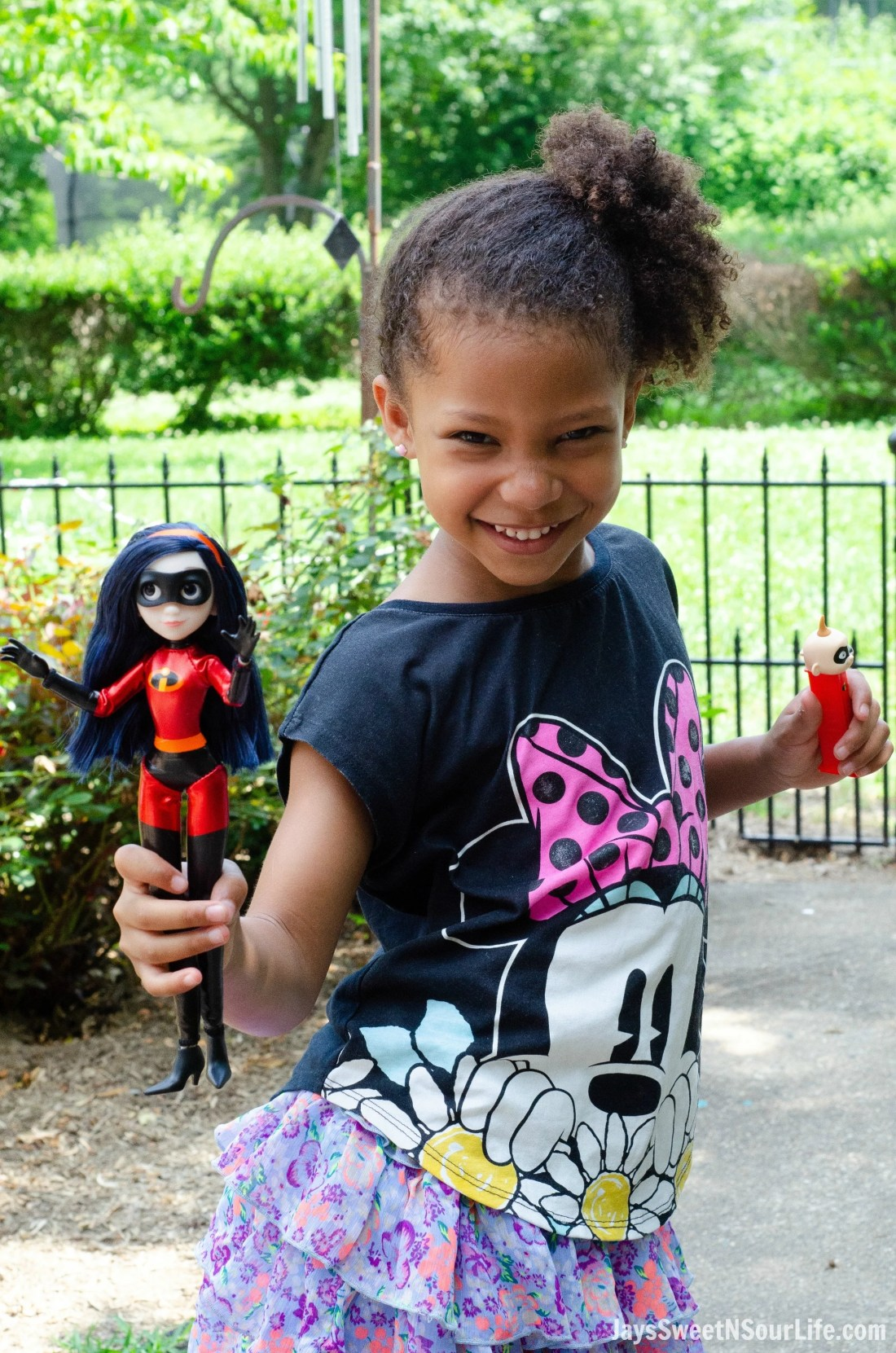 African American Girl Posing With Incredibles 2 Violet Action Figure. New Disney Pixars Incredibles 2 Toys + More | Incredibles 2 Gift Guide