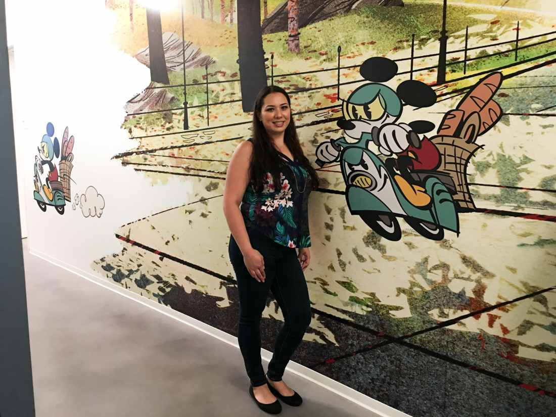 Jessica Simms Jays Sweet N Sour Life at Disney Channel animation Building posing with Disney Mural.
