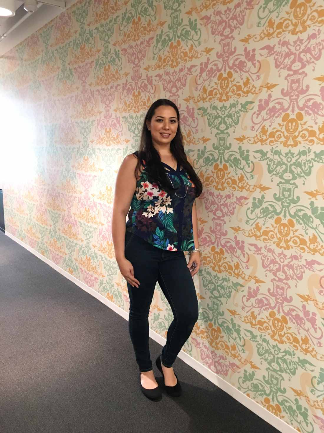 Jessica Simms Jays Sweet N Sour Life at Disney Channel animation Building posing with Disney Wall Art.