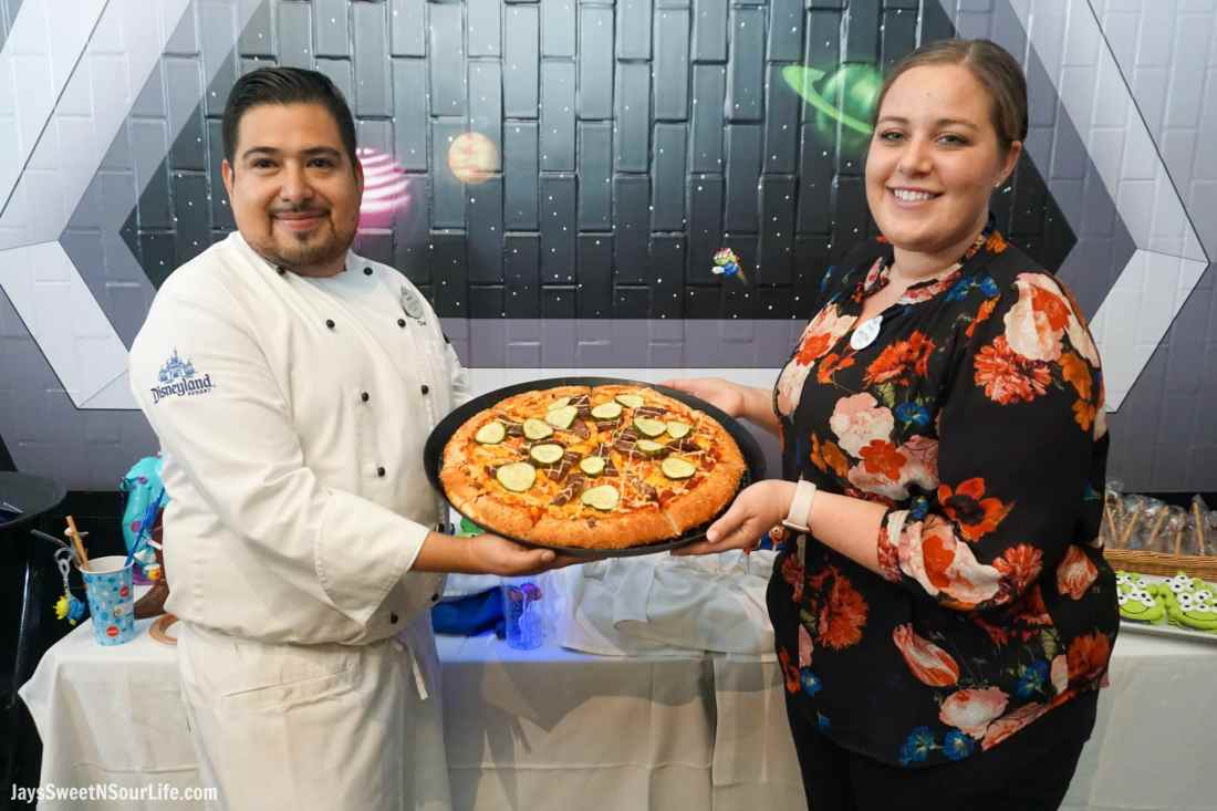 Pizza Planet Chefs Holding Cheeseburger Pizza. Pixar Fest at Disneyland runs from April 13 through September 3rd.