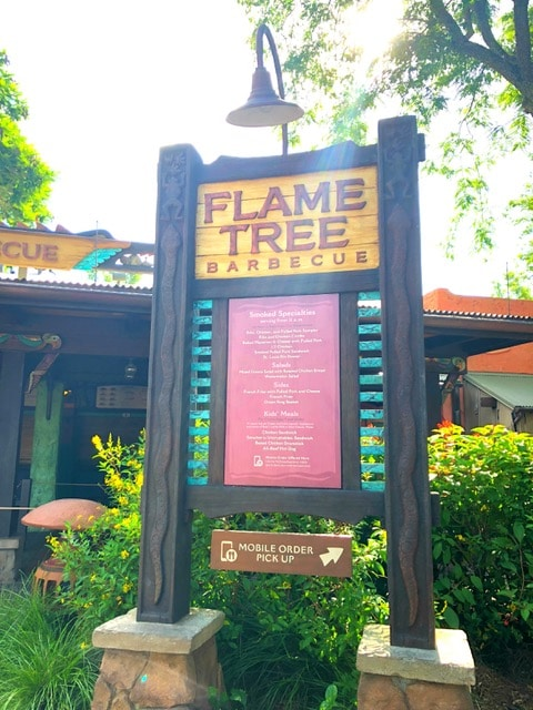 The Flame Tree Sign Disney World. The Best Meals Under Twenty Dollars in Walt Disney World - via JaysSweetNSourLife.com.