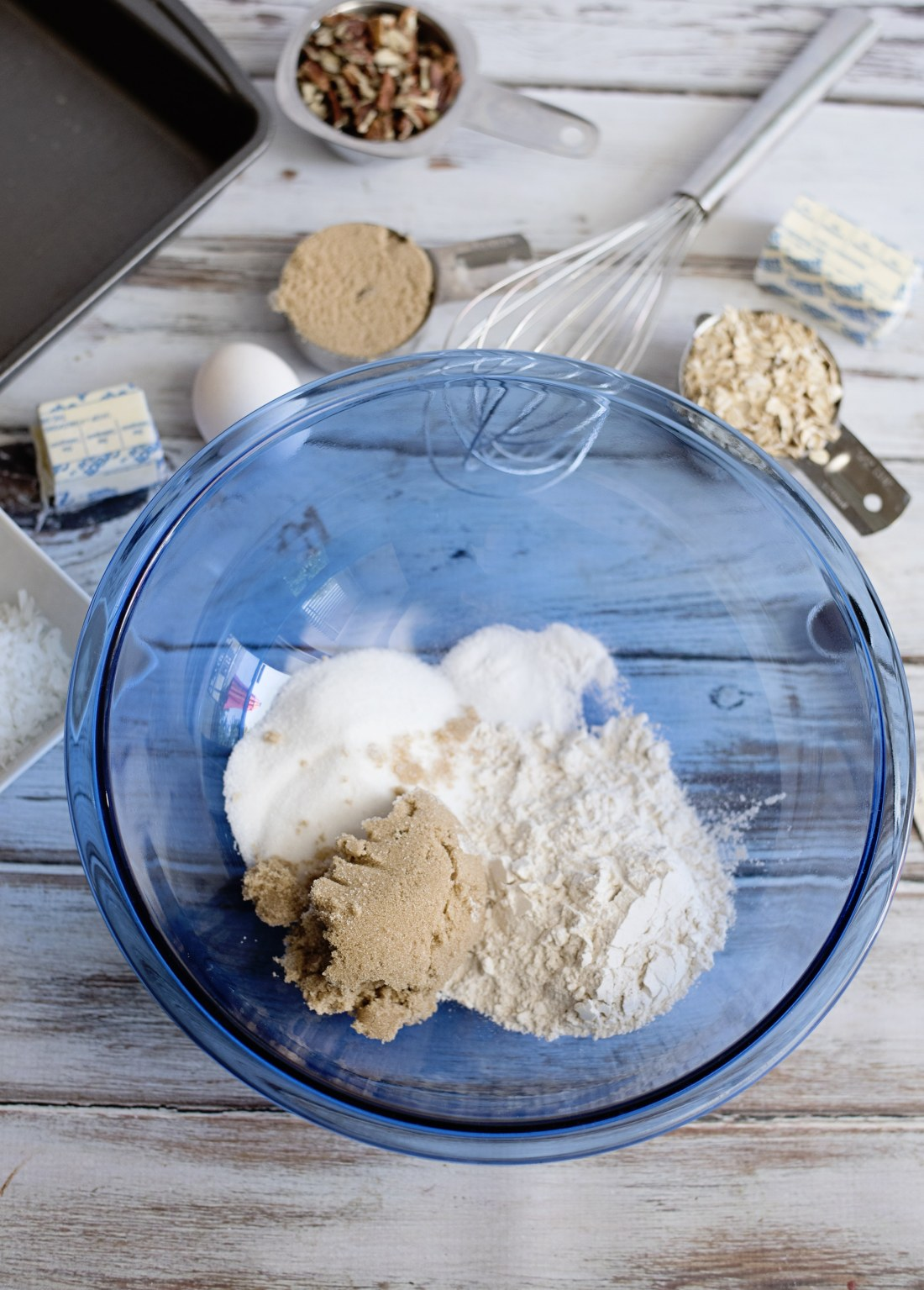 Oatmeal Cake with Coconut Pecan Frosting Step 1 place sugars in bowl. Fill your home with the smell of an easy to make Grandma's recipe Oatmeal Cake with Coconut Pecan Frosting.