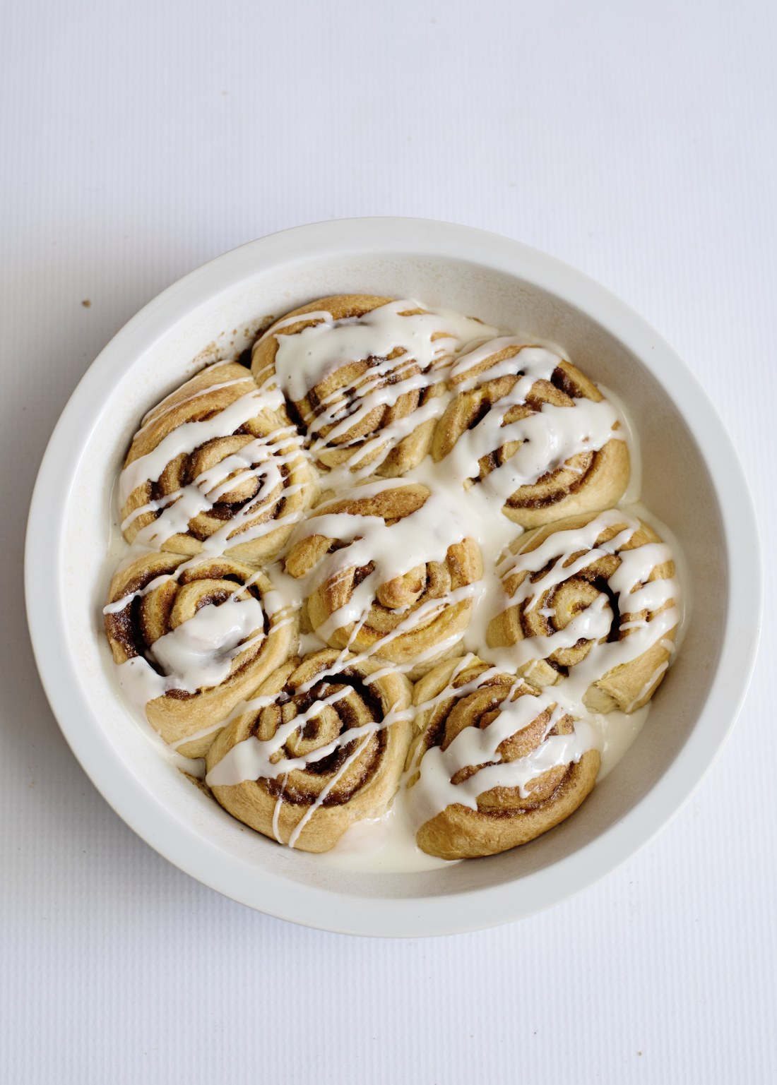 Pumpkin Spice Cinnamon Rolls Baked Icing Drizzle Fill your home with the delicious smell of these easy to make Pumpkin Spice Cinnamon Rolls.