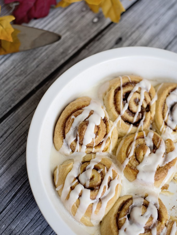 Pumpkin Spice Cinnamon Rolls Closeup Icing Drizzle. Fill your home with the delicious smell of these easy to make Pumpkin Spice Cinnamon Rolls.