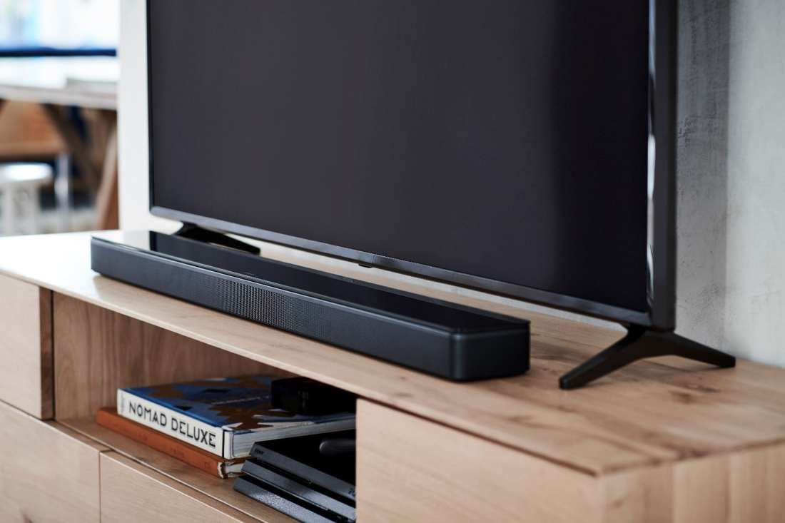 The stylish Bose Soundbar 500 is meant to be heard, not seen. Its thin profile fits discreetly under the TV screen, while its powerful acoustics fill the room with sound.