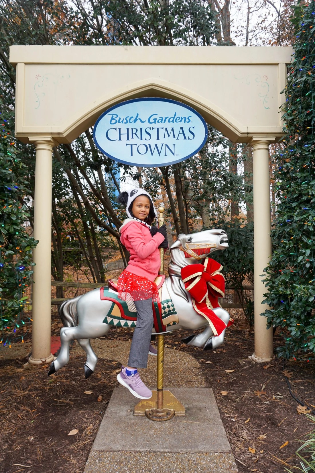 Girl On Carosel Horse 15 Instagram Worthy Walls Christmas Town Busch Gardens. Instagram Worthy Walls and Locations around Busch Gardens Christmas Town in Williamsburg Virginia.