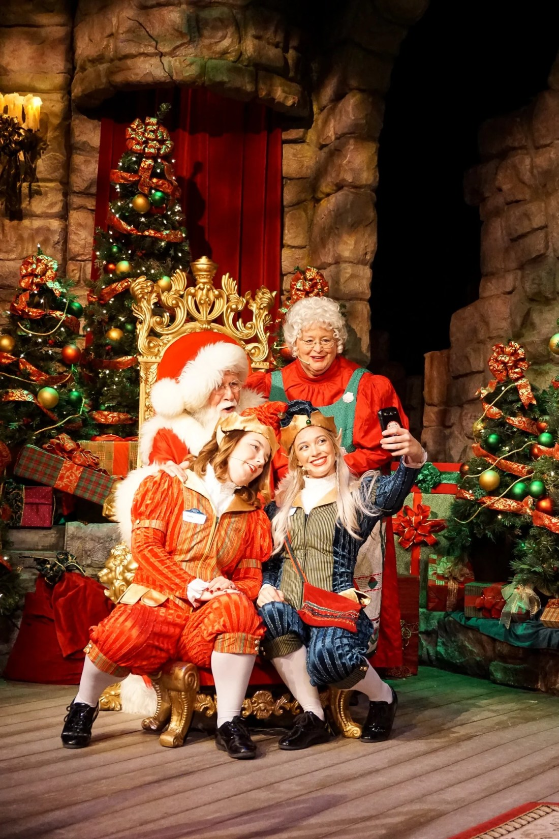 Santas Fireside Feast Elves Santa Selfie. Gather around as Santa recounts a classic Christmas story while elves prepare a scrumptious all-you-care-to-eat meal and Mrs. Claus dazzles the dining room with holiday cheer. Read more about this wonderful feast at Busch Gardens Christmas Town in Williamsburg, Virginia.
