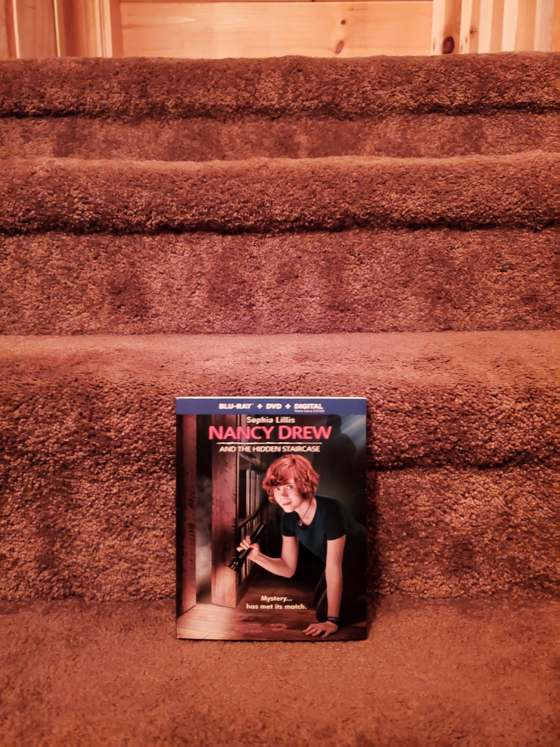 Nancy Drew And The Hidden Staircase DVD on Stairs. Nancy Drew And The Hidden Staircase film is heading home on Digital March 26, 2019 and on Blu-ray™ Combo Pack & DVD on April 2, 2019! If you haven't heard about the newest film in the Nancy Drew series then look no further. Check out all of the info below on what to expect with this family-friendly film.