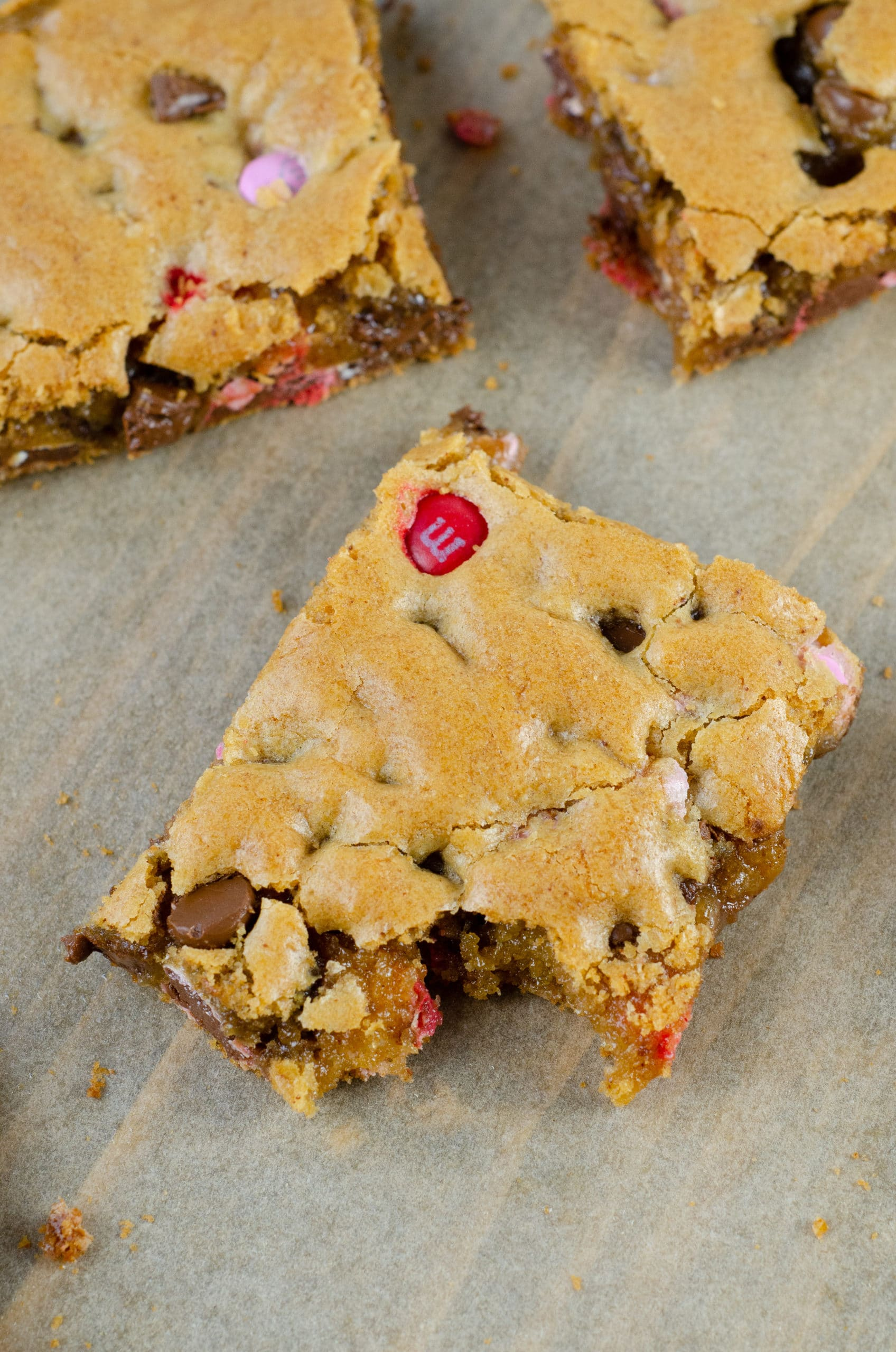 Browned Butter M&M Blondies Bite Bars. These Valentine's day themed Browned Butter M&M Blondies are the perfect way to say I heart you to someone special. I love to bake them for my little ones year-round. They are so chewy and chocolatey they make it easy for me to look like a master dessert chef.