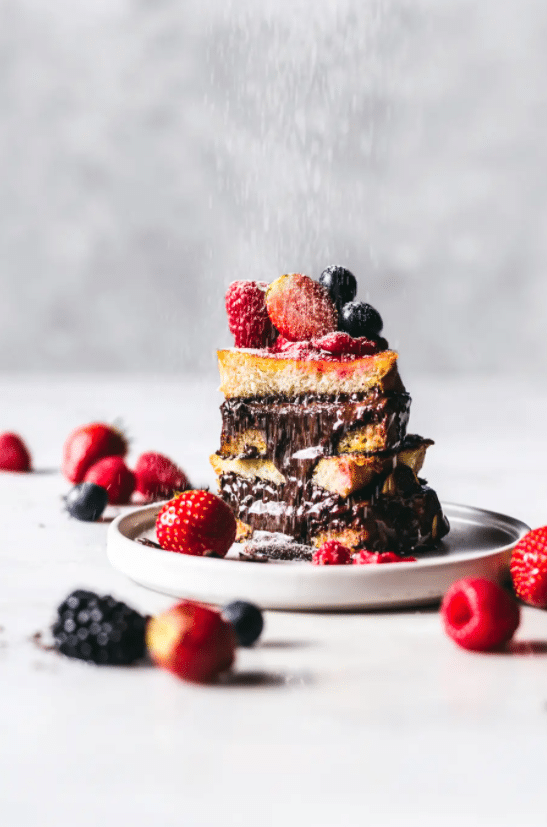 This Nutella & Dark Chocolate Stuffed French Toast recipe is what dreams are made of – think perfect slices of French toast stuffed with just the right mix of Nutella and dark chocolate, gently bathed in a berry compote sent directly from the heavens.
