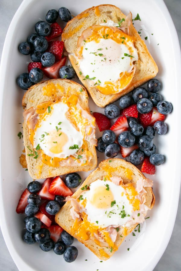 Perfect for Christmas morning, this Egg in a Hole with melty cheese and crispy ham come together quickly, but look stunning. Serve with a simple fruit salad if desired.