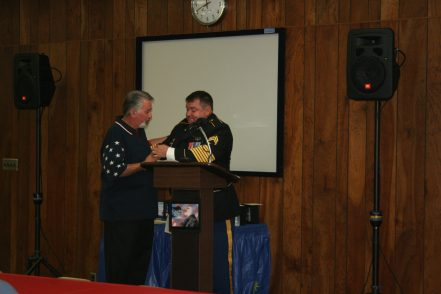 SSG Brondhaver presents his Humanitarian Service Award to Gary Cox