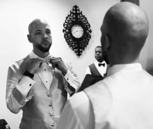 Groom in dressing room black and white photo prior to wedding ceremony