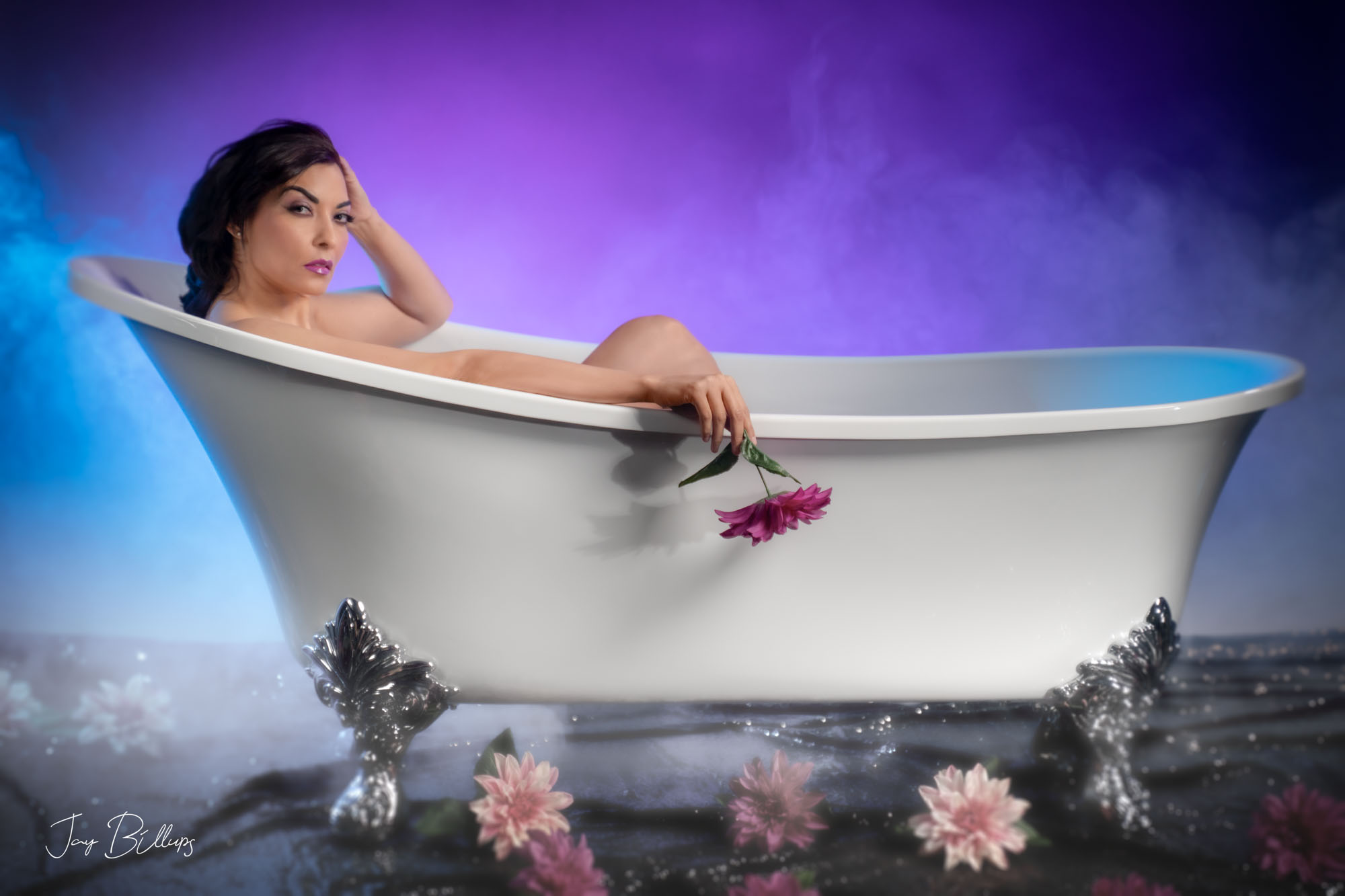 Latina in a clawfoot tub posing for boudoir