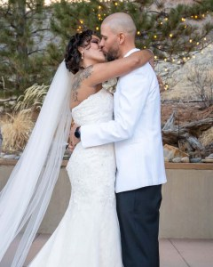 Bride and groom kiss at end of ceremony on Colorado Springs, CO