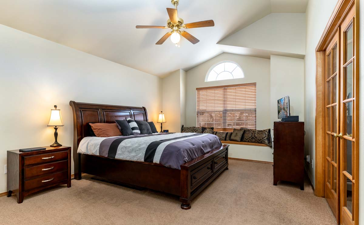 Real estate photo of master bedroom in a Colorado Springs home