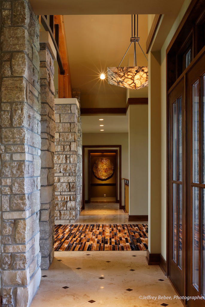 Hallway with stone supports and windows