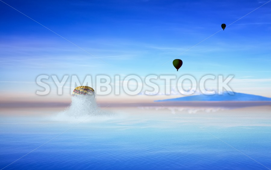 Balloon popping out of ocean - Jan Brons Stock Images