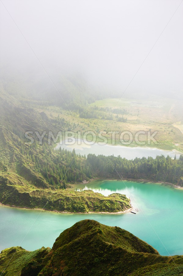 Blue lake in clouds - Jan Brons Stock Images