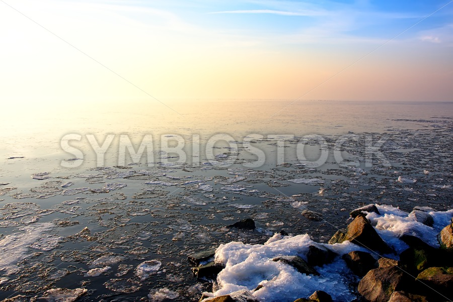 Sunset over Frozen Lake - Jan Brons Stock Images