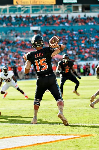 Miami QB Brad Kaaya attempts a pass from his endzone