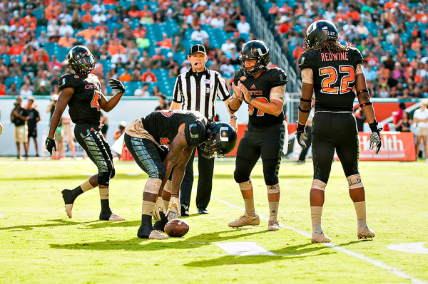 The Miami Hurricanes special teams downs a punt