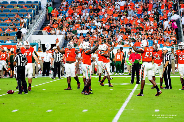 The Hurricanes defense tries to pump up the crowd at the start of the 2nd Quarter