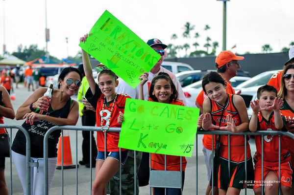 Young fans wait for the Miami Hurricanes to arrive