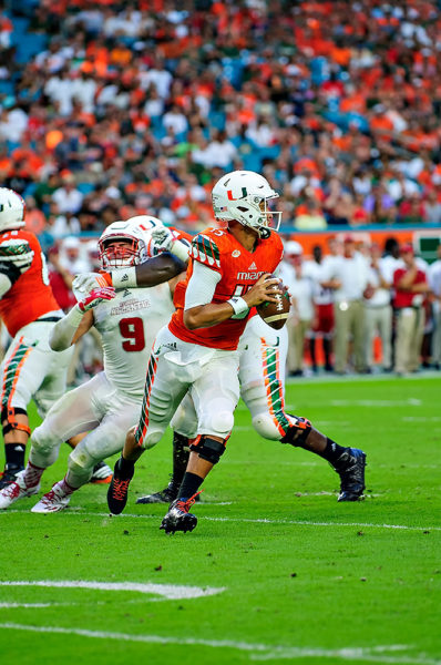Brad Kaaya looks downfield as he scrambles out of the pocket